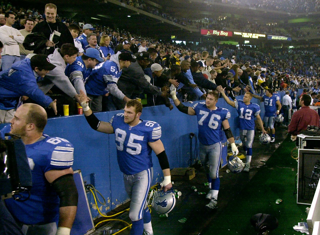 . Detroit Lion teammates salute the Lions fans at the end of Sunday\'s game against the Dallas Cowboys at the Pontiac Silverdome. The Lions won 15-10 over Dallas to end the season and their final game played at the Silverdome.