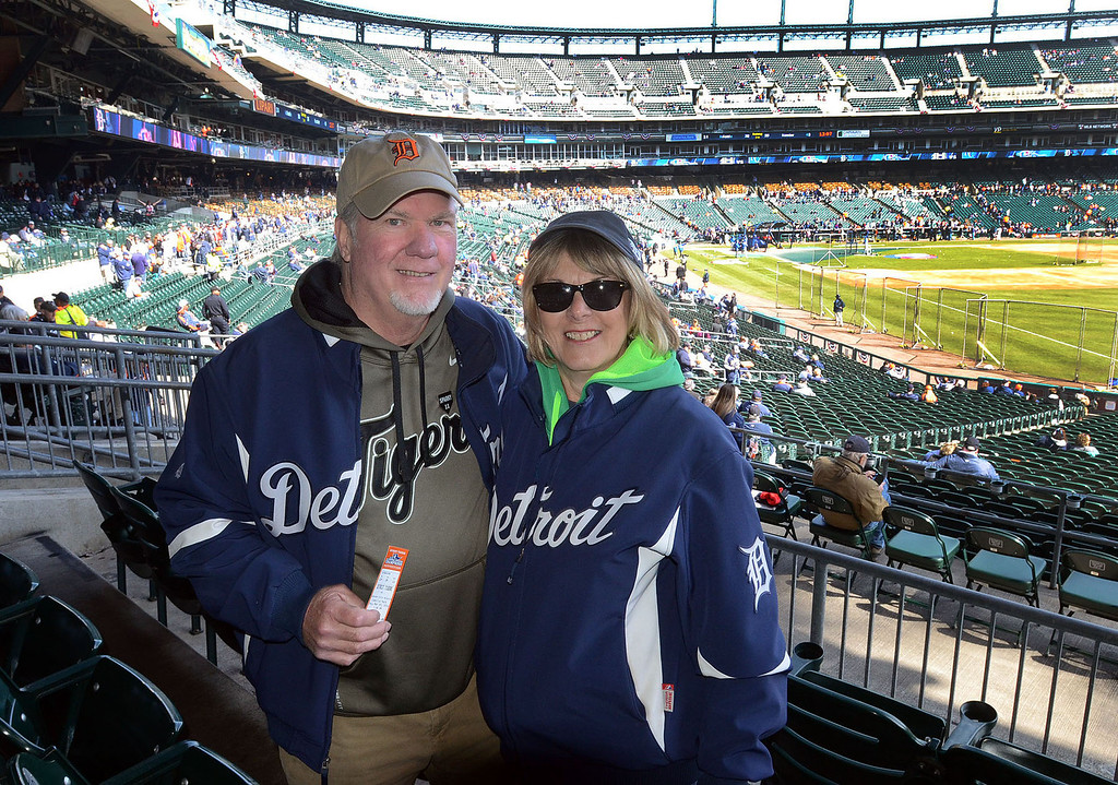 Description of . Don and Sue McGraw, of Springfield Twp., at their seats for the Tigers home opener game against Kansas City, pictured Monday March 31, 2014. This is Don's 43rd Opening Day he's attended for the Tigers. (Vaughn Gurganian-The Oakland Press)