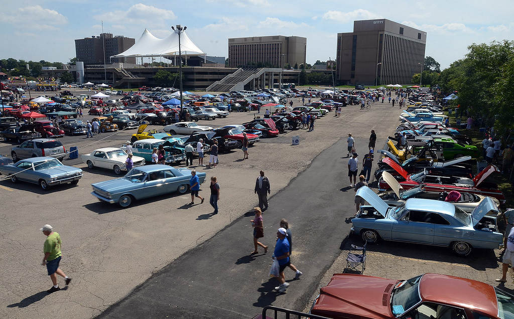 Description of . Classic cars fill Lot 9 in Pontiac during the 2013 Woodward Dream Cruise, Saturday August 17, 2013. (Oakland Press Photo:Vaughn Gurganian)