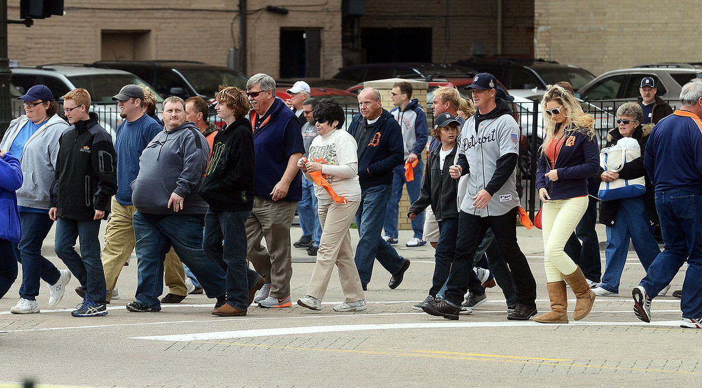 Description of . Fans head to Comerica Park for the start of Game 3 of the ALDS between the Tigers and Oakland A's, Monday October 7, 2013. (Oakland Press Photo:Vaughn Gurganian)