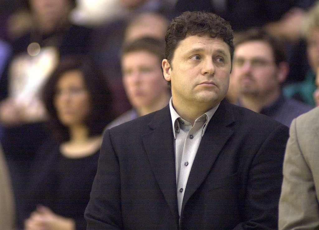 Description of . Oakland University mens basketball head coach Greg Kampe reflects as the national anthem is played prior to the start of his team's game against Western Michigan University, at the O'rena in Rochester, Mich., Saturday, December 29, 2001.