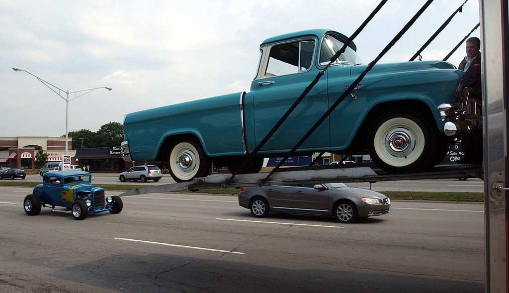 Description of . A 1953 GMC truck is lowered off a truck to be placed in the GMC-Buick display area in the parking lot of Athens Coney Island along Woodward Avenue in Royal Oak. (Oakland Press Photo/Vaughn Gurganian)