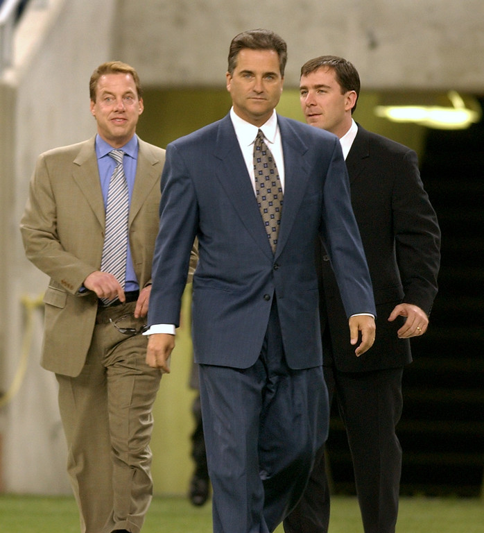 . Steve Mariucci, center, is introduced as the new head coach of the Detroit Lions Accompanying Mariucci are L-R: Vice Chairman William Clay Ford Jr, and Executive Vice President and Chief Operating Officer Tom Lewand.  Photo taken on Wednesday, February 5, 2003, during a press conference at Ford Field in Detroit, Mich.
