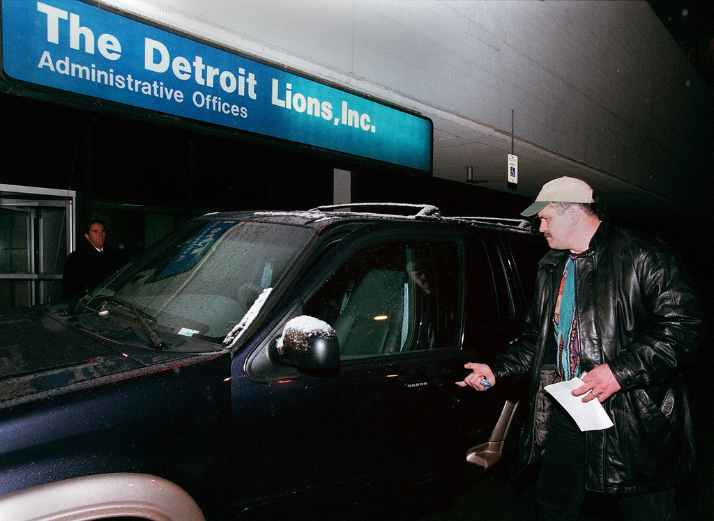 . Detroit Lions President and CEO, Matt Millen leaving the Detroit Lions offices at the Silverdome. earlier he stopped to talk to the news media just outside the Detroit Lions Administrative offices early this evening about the hiring of Marty Mornhinweg as the new Detroit Lions head coach and the release (firing?) of coach Gary Moeler.