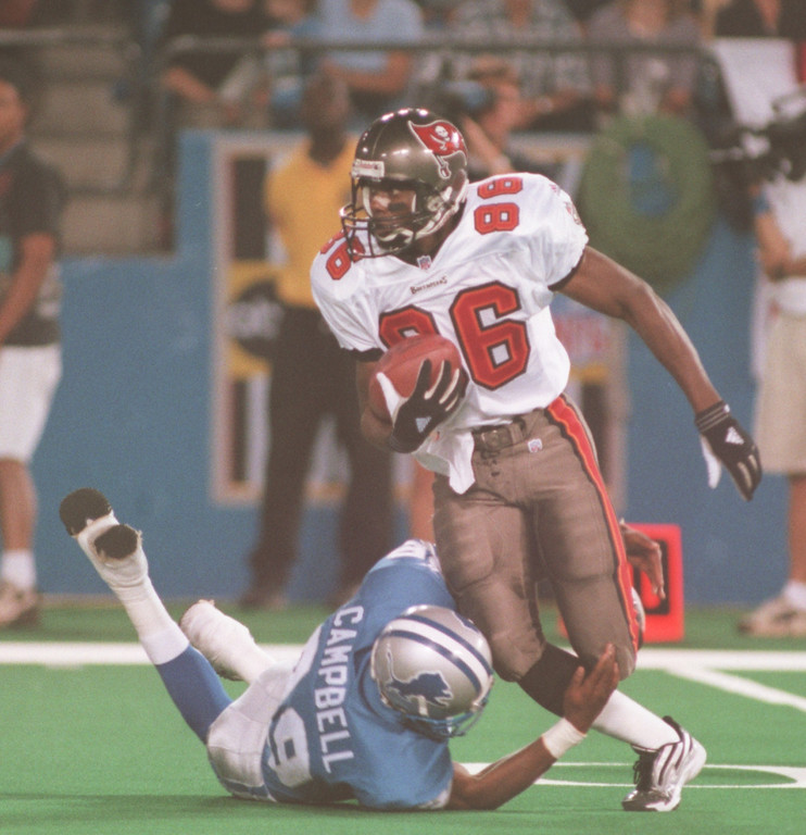 . Lamar Campbell(39) of the Detroit Lions trips up Tampa reciever Karl Williams (86) in the first down early in the first quarter during the Lions Monday night game against the Tampa Buccaneers at the Pontiac Silverdome.