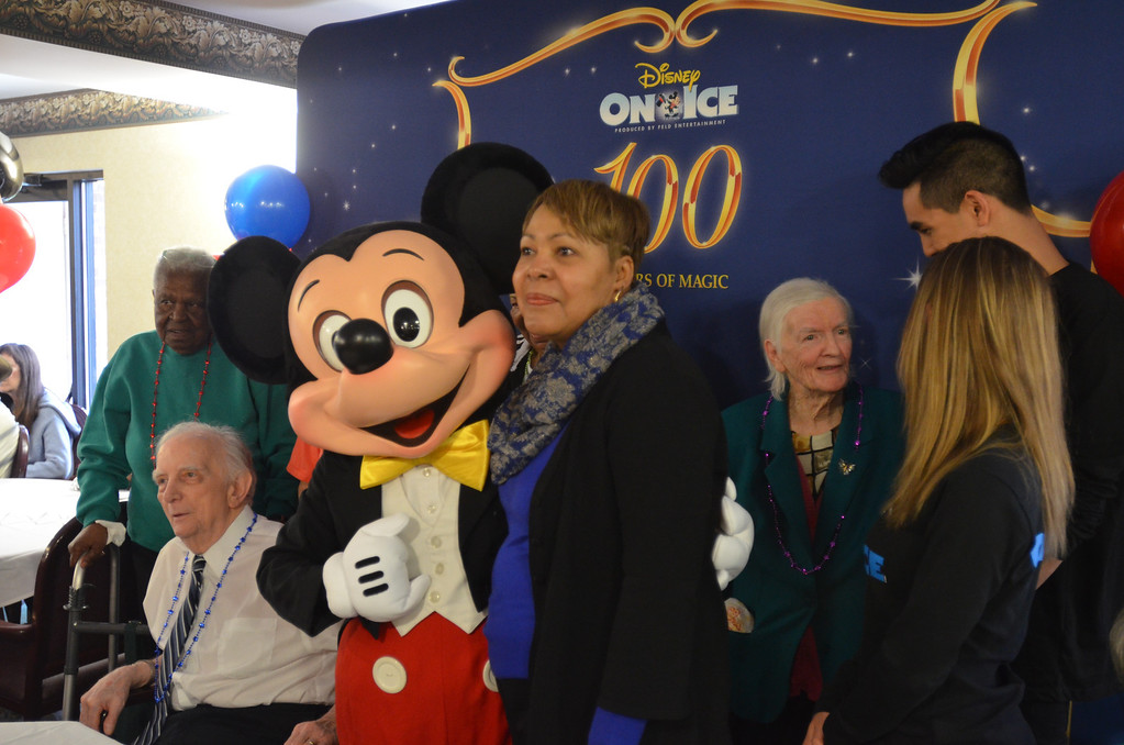 Description of . A number of visitors and organizers had a chance to pose with Mickey Mouse for a photo the 85th birthday anniversary party organized by Disney On Ice.