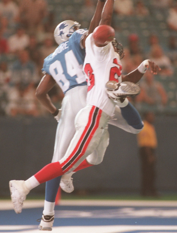 . Detroit Lions wide receiver Herman Moore has his catch attempt broken up by Atlanta Falcons cornerback Ronnie Bradford (#23) during first quarter action at the Pontiac Silverdome, Friday, August 14, 1998.