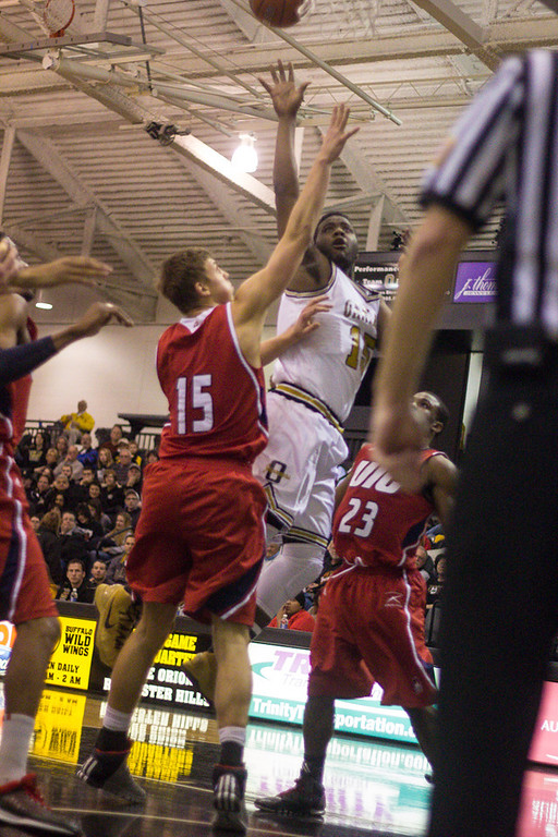 Description of . Neely attempts a shot on the basket. Photos by Dylan Dulberg/The Oakland Press