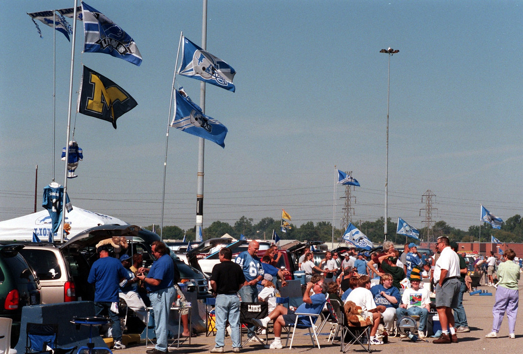 Description of . Fans tailgate outside the Pontiac Silverdome prior to the start of Sundays game against the Green Bay Packers. Lions won 23-15 over Green Bay.
