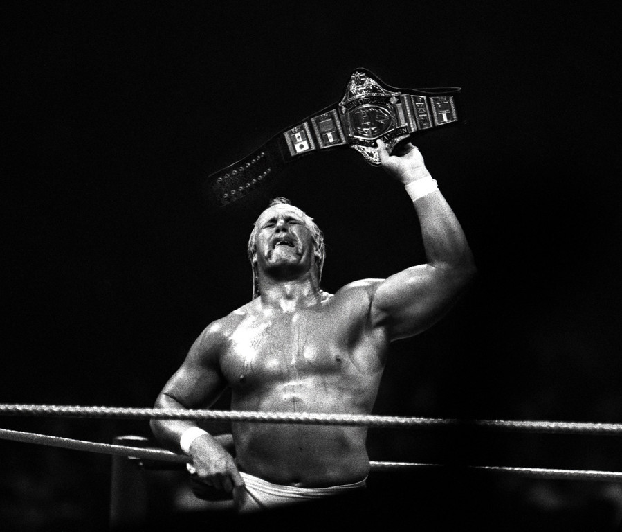 Description of . A weeping Hulk Hogan holding up the championship belt, is over come with tears after defeating Andre The Giant at the Pontiac Silverdome.  Photo taken 3-29-87.