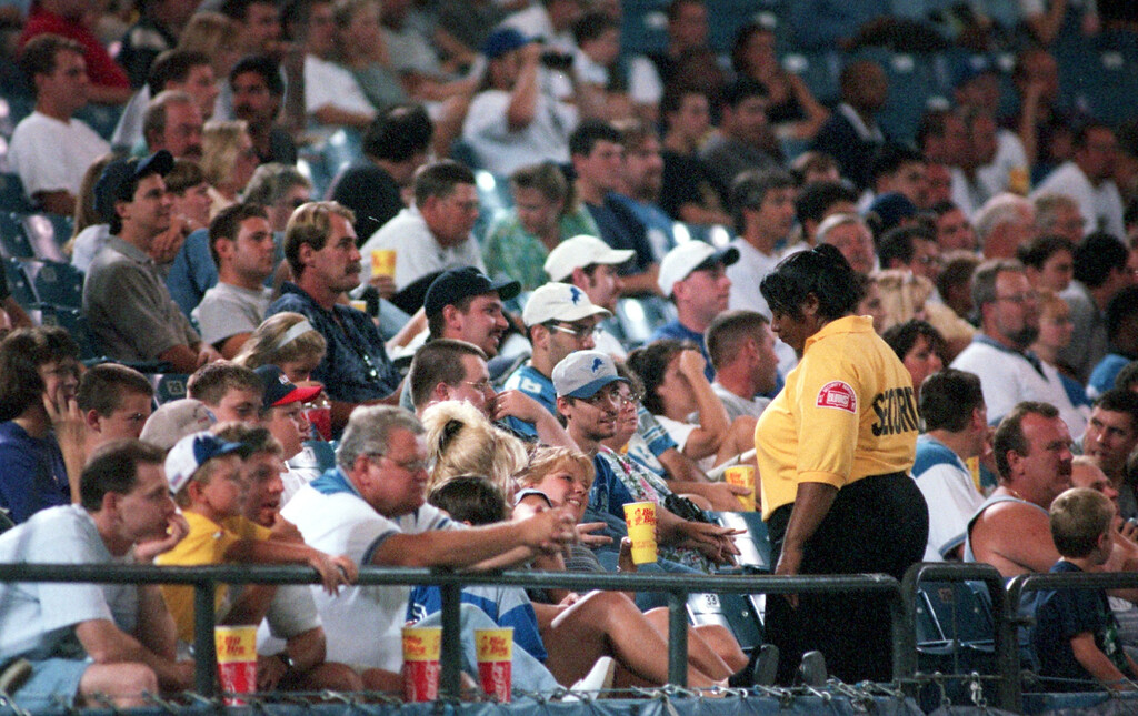 . Security keeps a watchful eye on the crowd during the preseason game pitting the Detroit Lions against the St. Louis Rams at the Pontiac Silverdome Thursday night.
