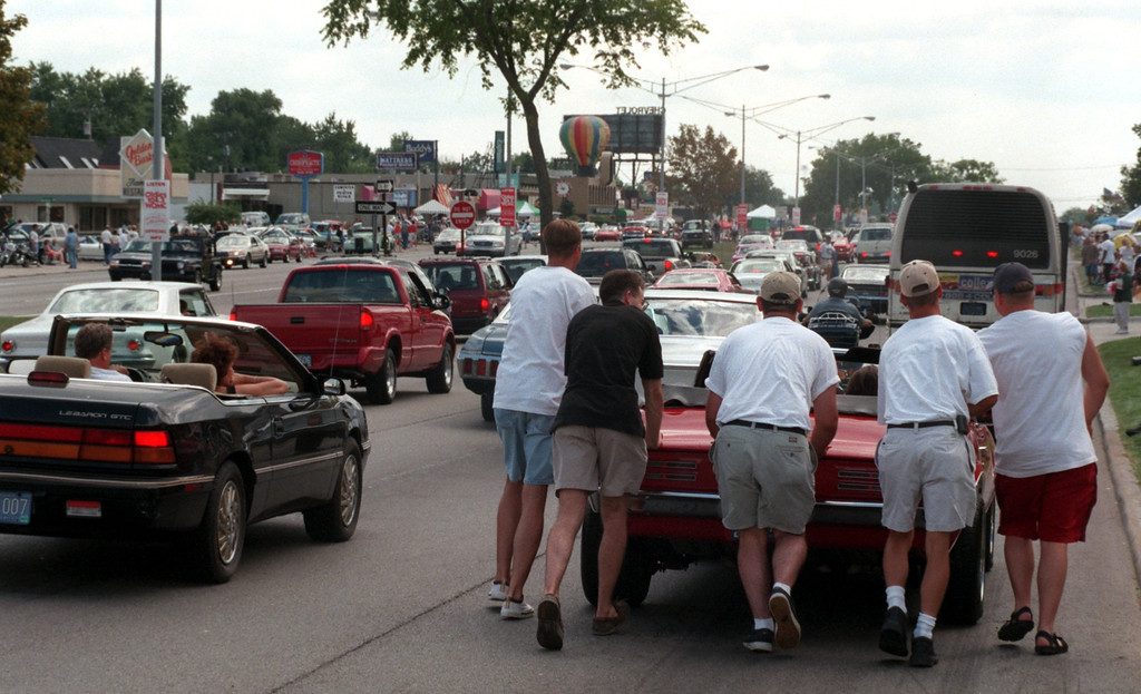 Description of . A group of guys push a overheated 1968 Firebird alonh Woodward Ave. in Royal Oak during the Fifth Annual Woodward Dream Cruise.