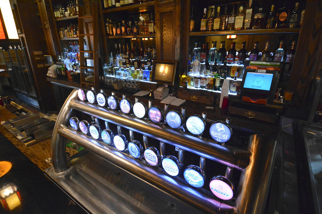 Description of . The main downstairs bar at Three Blind Mice pub in Mount Clemens has a tower of beer taps. Ray J. Skowronek/Digital First Media