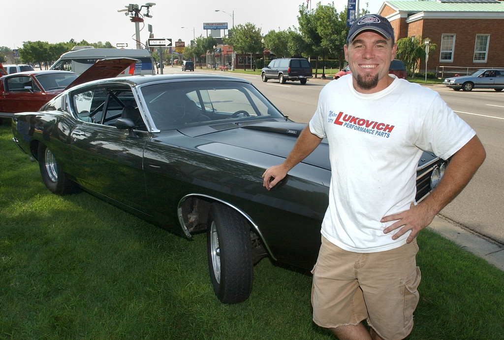 Description of . Chris Tom, of Mt. Clemens, with his 1969 Ford Torino GT during a press conference kicking off the 2005 Woodward Dream Cruise in Ferndale, Tuesday August 16, 2005.