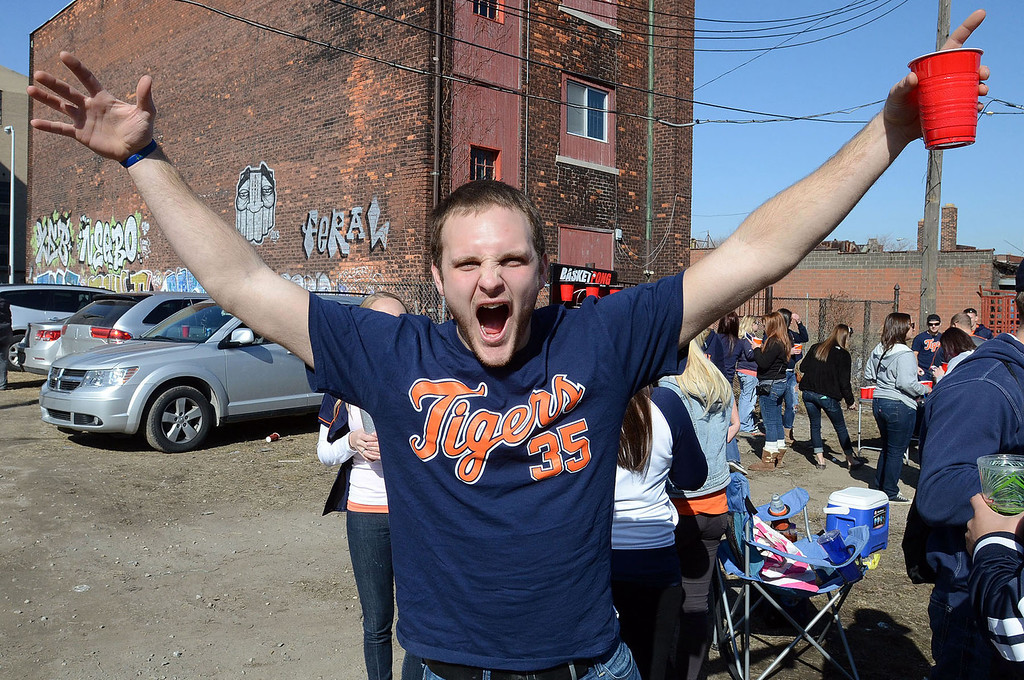 Description of . Kevin Stier, of Fraser, celebrates Opening Day before heading into Comerica Park for the Detroit Tigers-Kansas City season opener, Monday March 31, 2014. (Vaughn Gurganian-The Oakland Press)