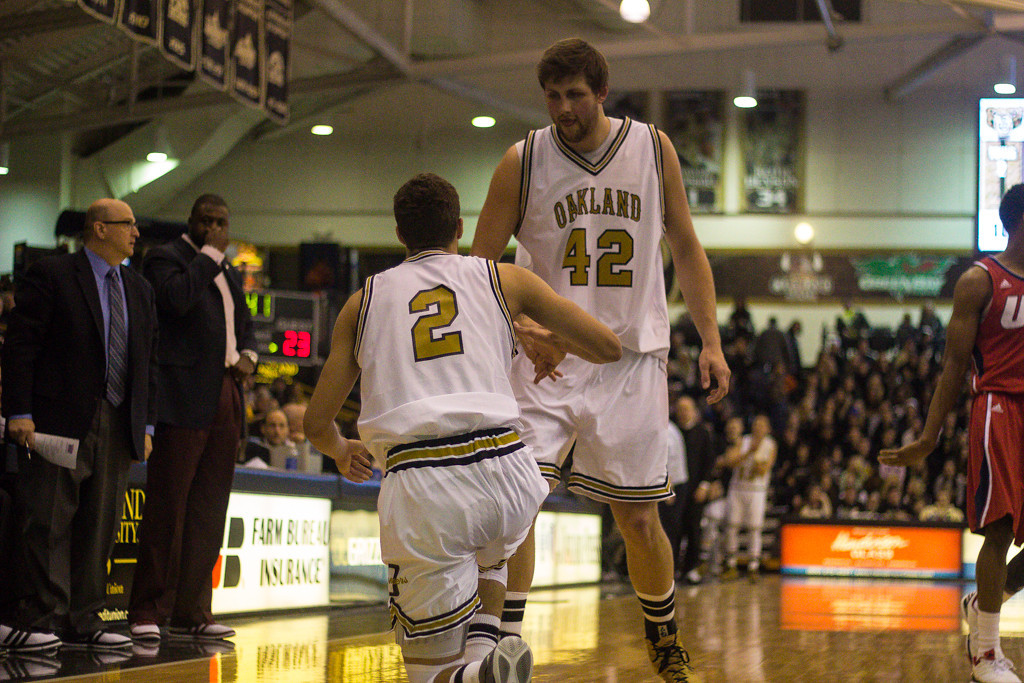 Description of . Petros helps up teammate Williams. Photos by Dylan Dulberg/The Oakland Press