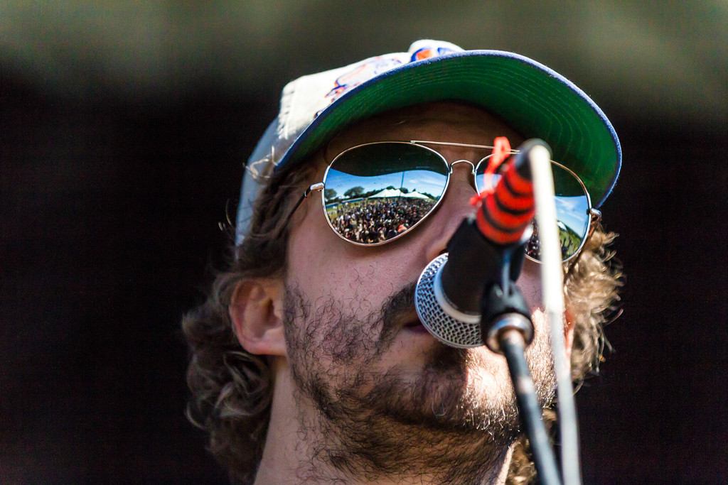 Description of . Phosphorescent, the name of the band behind American singersongwriter Matthew Houck, plays an energetic folksy set to a rapidly-growing crowd.