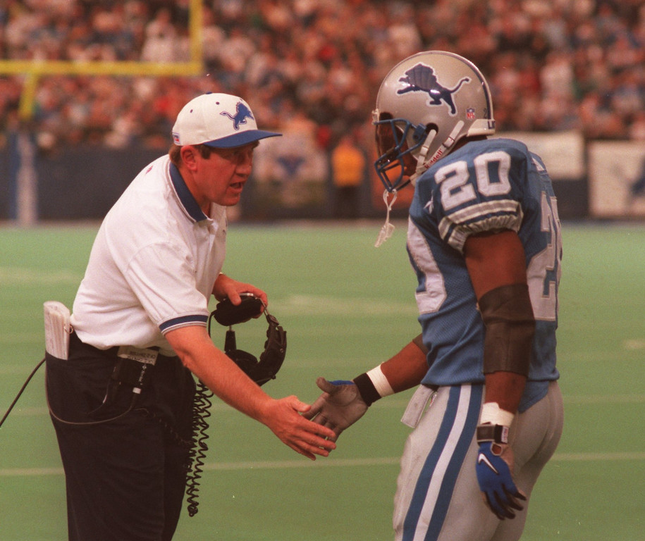 . Lions coach Bobby Ross congradulates Barry Sanders after he ran wild for a long gainer.