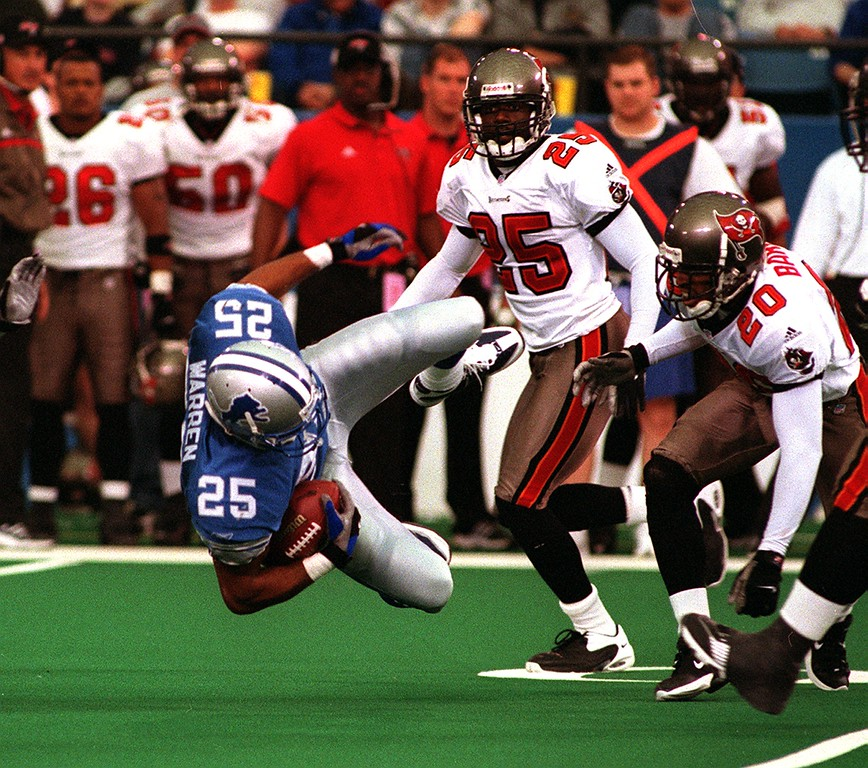 . Lions running back Lamont Warren takes a tumble against the Bucs. The Tampa Bay Buccaneers beat the Detroit Lions 20-17 at the Pontiac Silverdome.