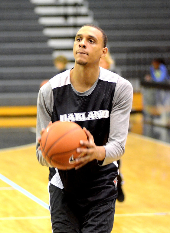 Description of . Oakland University forward Tommie McCune during practice Tuesday.    Tuesday, November 5, 2013.  The Oakland Press/TIM THOMPSON