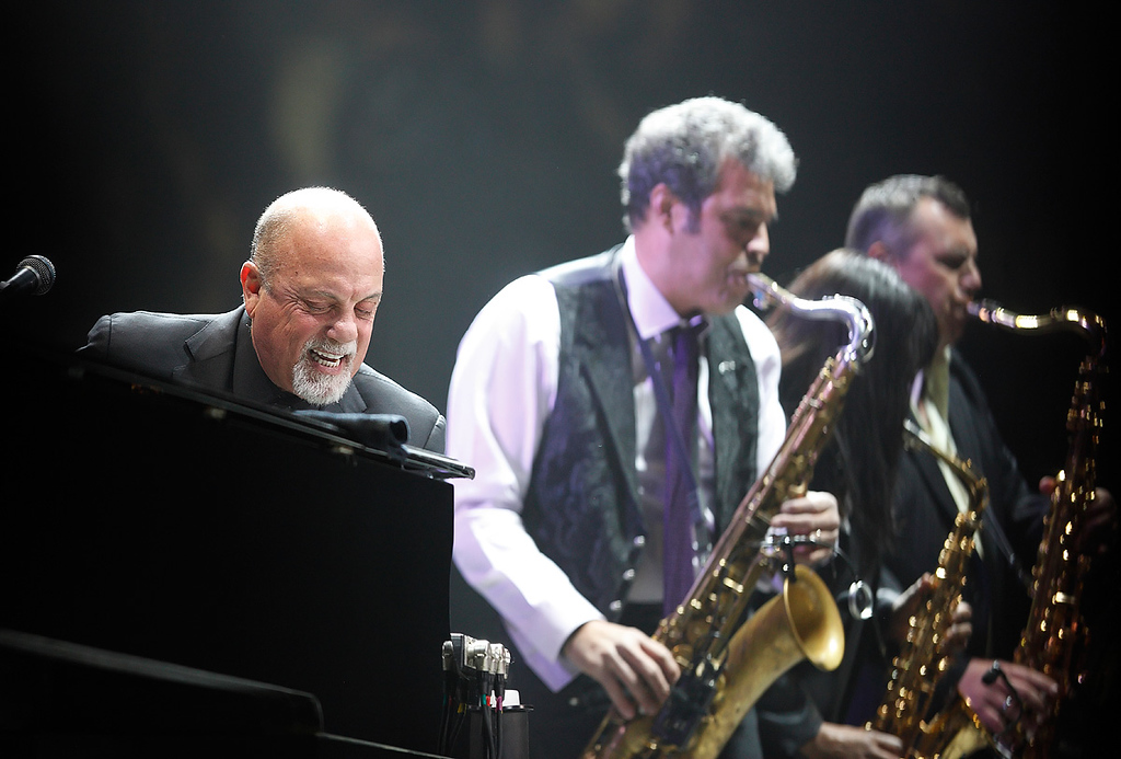 Description of . Billy Joel with his saxophonist, Mark Rivera, perform at The Palace of Auburn Hills on Saturday, Feb. 15, 2014. Photo by Ken Settle