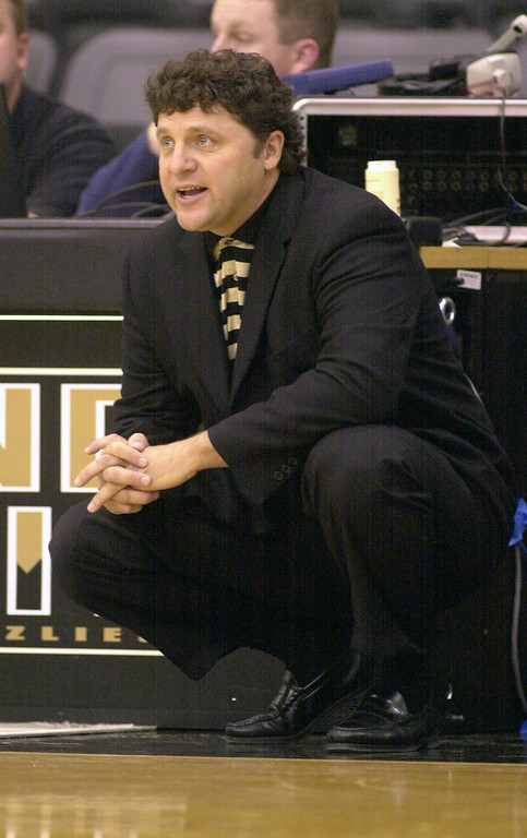 Description of . Oakland University mens basketball head coach Greg Kampe gives orders to his team as they played the Premier All-Stars AAU, during first half action, Saturday, November 10, 2001, at the O'rena in Rochester Hills, Mich.