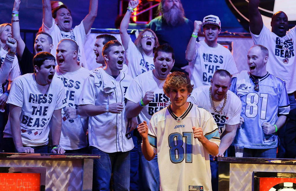 Description of . Ryan Riess and his fans react as the river card is turned eliminating Amir Lehavot and advancing him to the final two players during the World Series of Poker Final Table, Tuesday, Nov. 5, 2013, in Las Vegas. (AP Photo/Julie Jacobson)