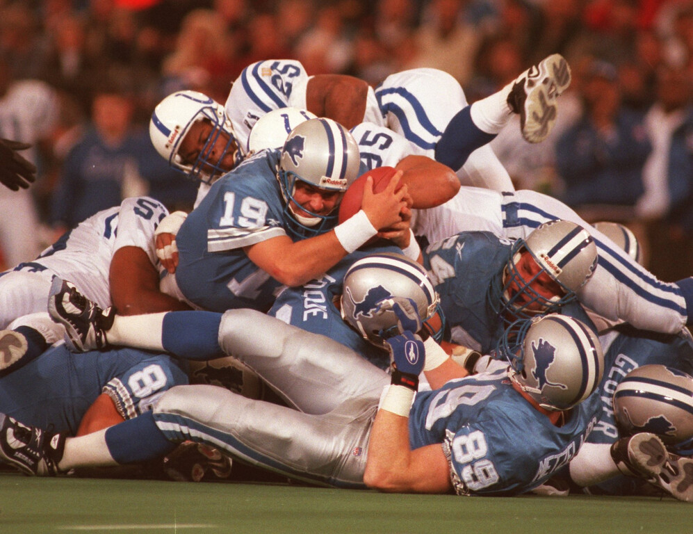 . Detroit Lions quarterback Scott Mitchell streatches to pickup a first down late in the first quarter during Sunday\'s game played against the Indianapolic Colts. The LIons won 32-10.