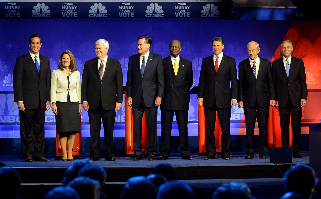 Description of . (from left) Republican candidates Rick Santorum, Michele Bachmann, Newt Gingrich, Mitt Romney, Herman Cain, Rick Perry, Ron Paul and Jon Huntsman appear just moments before the start of The Republican Presidential Debate at Oakland University, Wednesday November 9, 2011. (Oakland Press Photo By: Vaughn Gurganian)