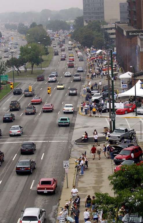 Description of . The streets start to fill up for the Woodward Dream Cruise after the rain passed Saturday morning just before noon.