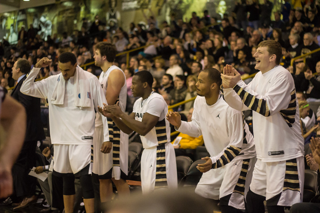 Description of . Oakland University players react to a free throw. Photo by Dylan Dulberg/The Oakland Press