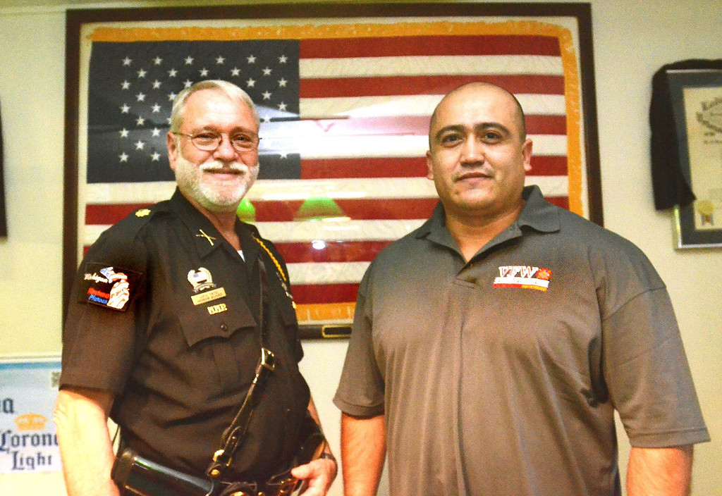 Description of . Honor Guard Howard White, left, and new post commander Mo De La O at VFW Post 1370 in Pontiac.     Friday, July 19, 2013.  The Oakland Press/TIM THOMPSON