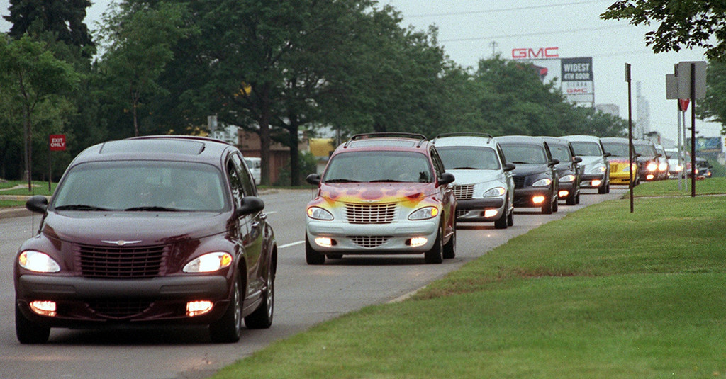 Description of . Hundreds of PT Cruisers make their way down Woodward Ave. twords Royal Oak to kick-off an early start to this year\'s Dream Cruise.