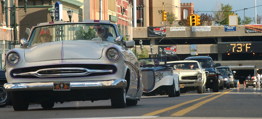 Description of . Dream Cruise riders show off their vehicles as they head northbound on South Saginaw Street.  Photo taken on Friday, August 15, 2008, in Pontiac, Mich.  (The Oakland Press/Jose Juarez)