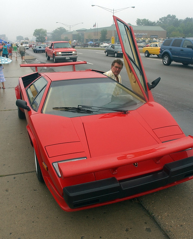 Description of . Silvio Scappaticci, of Plymouth, gets into his 1986 Lamborghini Countach to cruise Woodward Ave. in Royal Oak during the 2006 Woodward Dream Cruise.