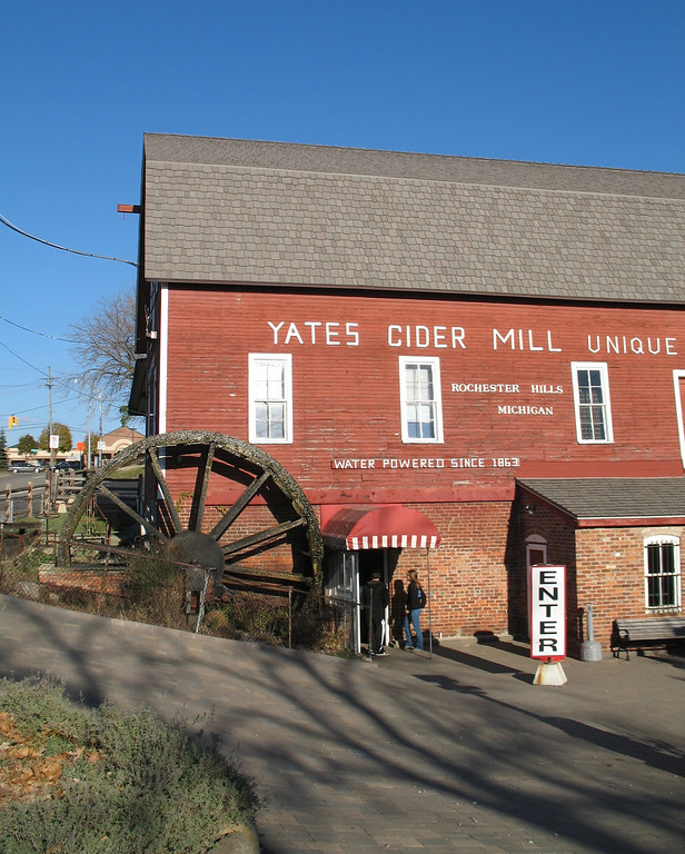 Description of . People entering Yates Cider Mill in Rochester Hills.