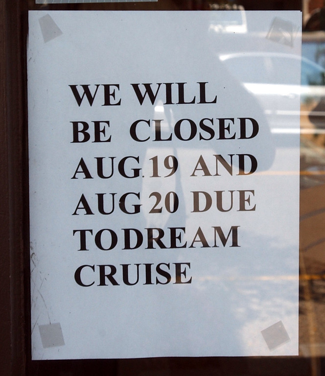Description of . A sign posted on the front window of the Townsend Hotel Bakery will be closed due to this weekends Dream Cruise.