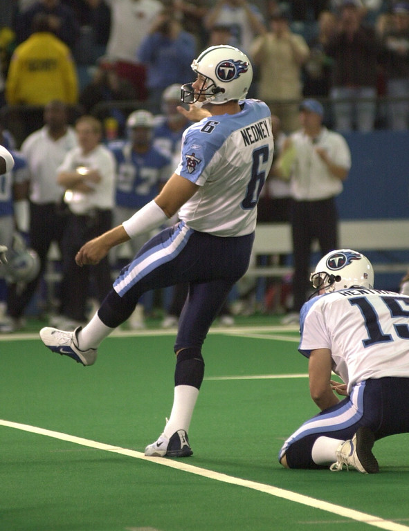 . Titans kicker Joe Nedney watches his game-winning field goal go through the uprights to beat the Detroit Lions 27-24  Sunday, October 21, 2001 at the Pontiuac Silverdome.