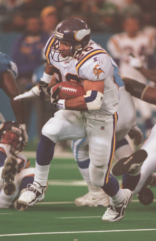 . Minnesota Vikings Running back Robert Smith running through the Detroit Lions defensive Line.  Smith ran for 134 yards on 19 carries.  The Vikings beat the Lions 34-13 at the Pontiac Silverdome.