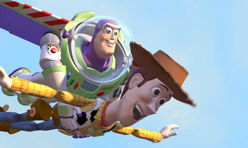 Description of . Buzz Lightyear gives a ride to Woody the cowboy in Pixar's