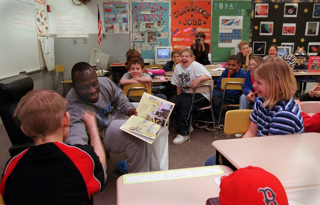 """. Detroit Lions running back Sedrick Irvin hits fist withPeter Shaw, 10. Irvin was reading to Dave Abbott\'s 4th grade class at Pine Tree Elementary School in Lake Orion.  Irvin was reading Dr. Seuss\' \""""Oh, The Places You Will Go.\"""""""