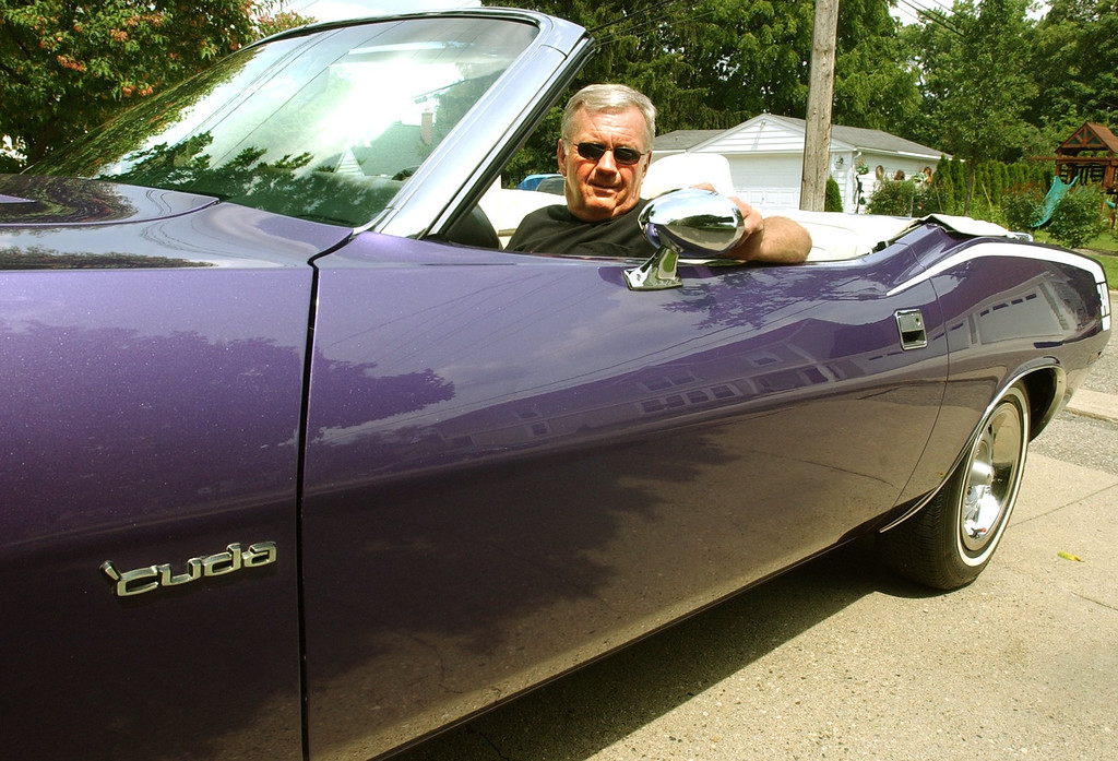 . Lynn Miller of Rochester, getting his purple Barricuda ready for the Dream Cruise. The Oakland Press/TIM THOMPSON