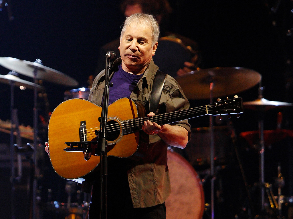 Description of . Paul Simon performs in his On Stage Together tour with Sting at The Palace of Auburn Hills, Wednesday, Feb. 26, 2014. Photo by Ken Settle