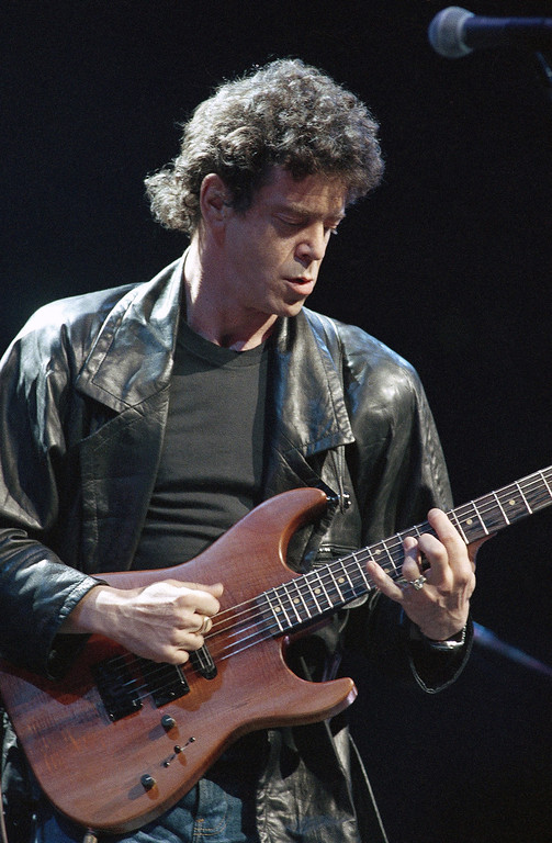 Description of . FILE - In a June 13, 1986 file photo, Lou Reed performs during musical number at a benefit in Chicago, for Amnesty International. Reed's literary agent Andrew Wylie says the legendary musician died Sunday morning, Oct. 27, 2013 in Southampton, N.Y., of an ailment related to his recent liver transplant. He was 71. (AP Photo/Fred Jewell, File)