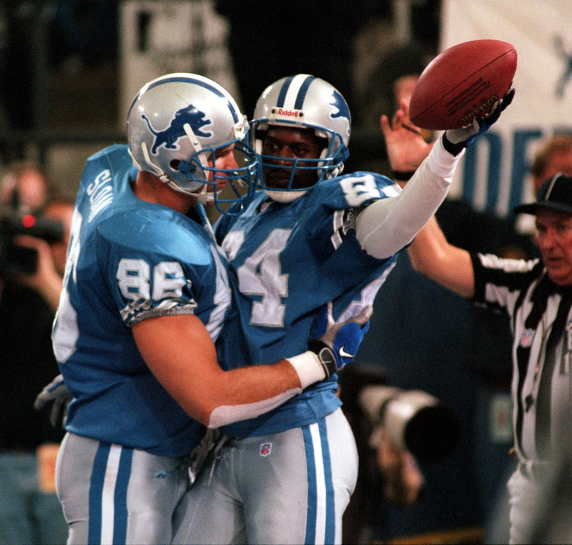 . Detroit Lions wide receiver Herman Moore celebrates his touchdown catch with teammate David Sloan that tied the game at 13-13 in the fourth quarter with the Pittsburgh Steelers at the Silverdome Thursday. Detroit went on to win in overtime 19-16.