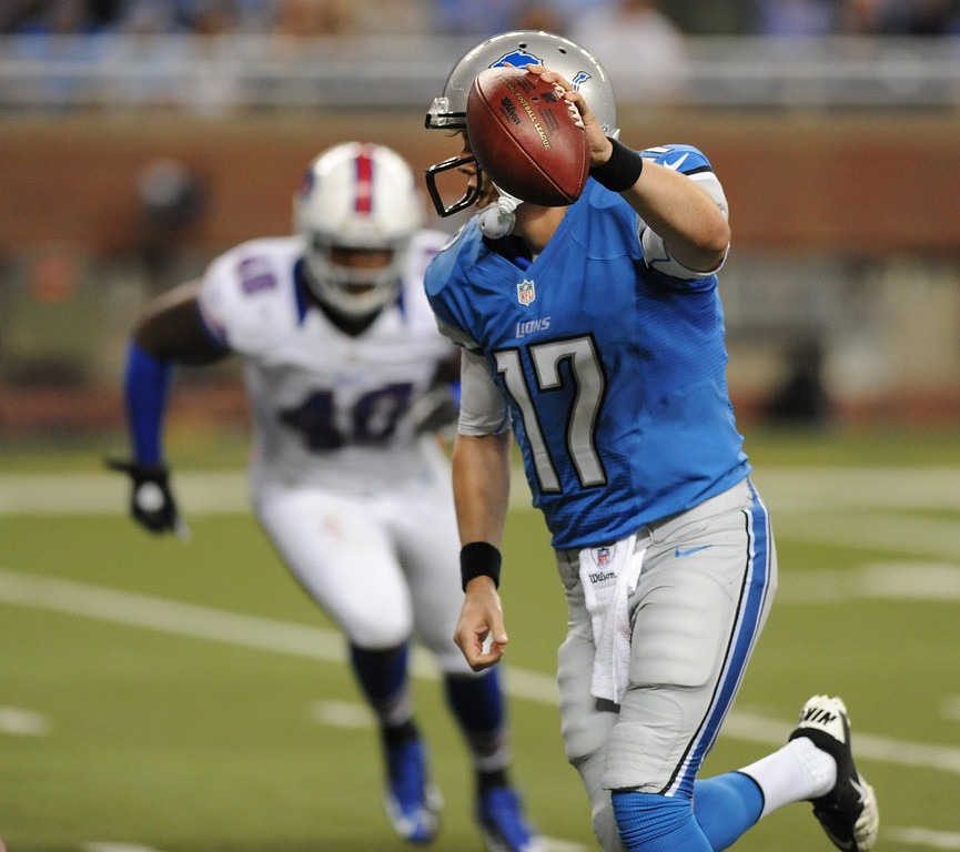 . Detroit Lions quarterback Kellen Moore runs for a one yard touchdown against the Buffalo Bills right during fourth quarter action.  The Lions beat the Bills, 38-32.  Photo taken on Thursday, August 30, 2012, at Ford Field in Detroit, Mich.  (Special to The Oakland Press/Jose Juarez)