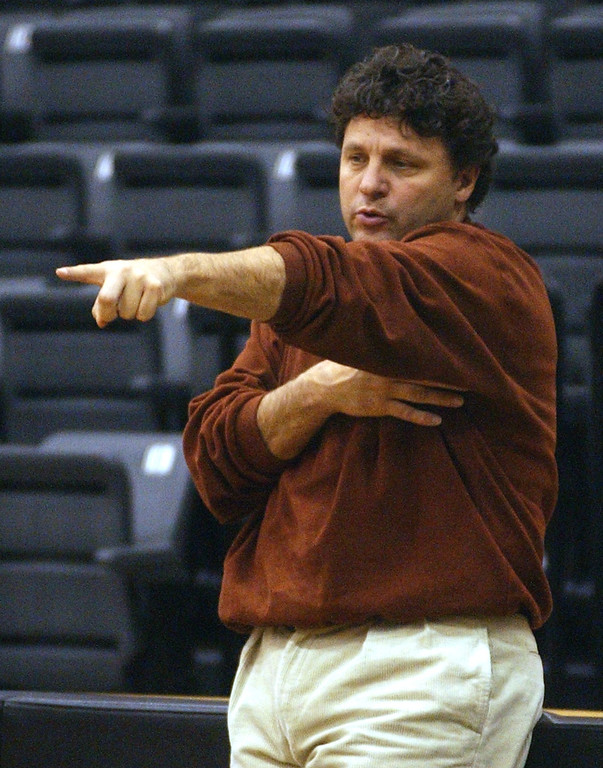 Description of . Oakland University mens head basketball coach Greg Kampe gives instructions to his team during practice Monday November 18, 2002 at Oakland University.
