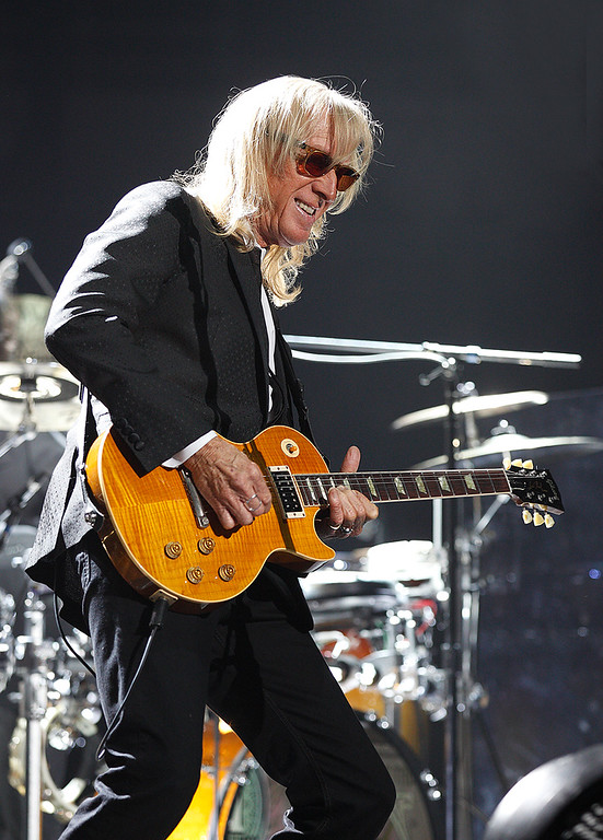 Description of . Longtime Elton John Band guitarist, Davey Johnstone performs at Joe Louis Arena on Friday night. Photo by Ken Settle