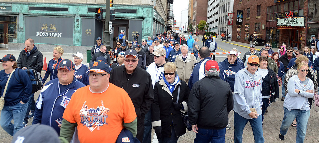 Description of . Fans make their way into Comerica Park for the start of Game 3 of the ALDS between the Tigers and Oakland A's, Monday October 7, 2013. (Oakland Press Photo:Vaughn Gurganian)