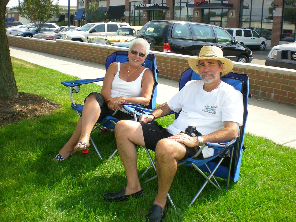 Description of . Suzanne and Richard Hubanks of Commerce Township -�at a prime viewing spot in Royal Oak -�love watching the Dream Cruise, and are such dedicated cruising fans, they began watching cruisers on Woodward Avenue on weekends starting in May.�(Oakland Press Photo/Carol Hopkins)